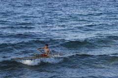 Confident filipino child captain on his home made raft in Leyte, Philippines, Tropical Asia Stock Images