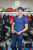 Confident Firefighter Holding Clipboard At Fire Royalty Free Stock Images