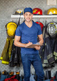 Confident Firefighter Holding Clipboard At Fire Royalty Free Stock Photos