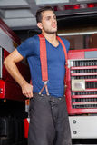 Confident Firefighter Standing Against Firetruck Royalty Free Stock Image