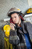 Confident Firefighter Using Walkie Talkie Royalty Free Stock Image