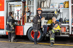 Confident Firefighters By Truck At Fire Station Royalty Free Stock Photos