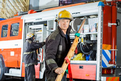 Confident Fireman Holding Wooden Stretcher Royalty Free Stock Photo