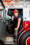 Confident Fireman Sitting In Truck Stock Image
