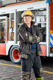 Confident Fireman Standing Against Truck Royalty Free Stock Photo