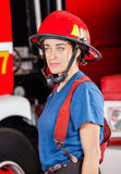 Confident Firewoman In Red Helmet Standing Against Royalty Free Stock Photography