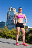 Confident and fit hispanic girl in a sports bra stock images