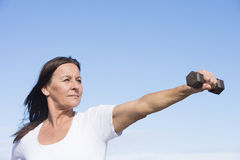 Confident fit mature woman exercising outdoor Royalty Free Stock Photos