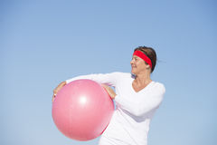 Confident fit and sporty senior woman Stock Photo