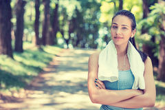 Confident fit woman with white towel resting after workout. Portrait young attractive confident fit woman with white towel resting after workout sport exercises Royalty Free Stock Images