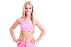 Confident fitness girl on white background with text area Royalty Free Stock Images