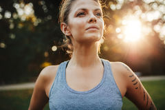 Confident fitness model in park Royalty Free Stock Image