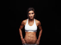 Confident fitness woman wearing sport bra Royalty Free Stock Photography