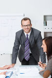 Confident friendly business manager stock images