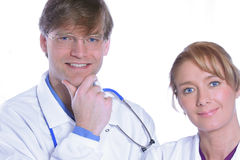 Confident and friendly medical team. Man and woman in late thirties Royalty Free Stock Images