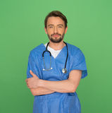 Confident friendly young male doctor or nurse Stock Photo