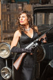 Confident Gangster Woman with Gun Stock Image