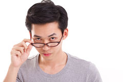 Confident genius nerd man looking at you, hand holding eyeglasses Royalty Free Stock Photos
