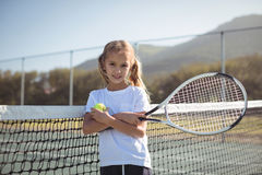 Free Confident Girl Holding Tennis Racket And Ball At Court Stock Image - 96121061