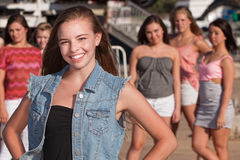 Confident Girl with Jealous Friends Stock Image