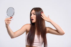 Confident girl likes her hairstyle Stock Images