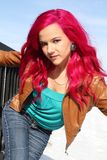 Confident girl with pink hair Stock Photography