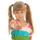 Confident girl pointing forward Stock Image