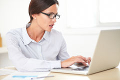 Confident girl secretary using her computer Royalty Free Stock Image