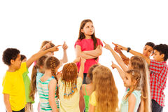 Confident girl stand in the circle of friends Royalty Free Stock Image