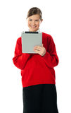 Confident girl using wireless portable device Royalty Free Stock Photos