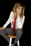 Confident girl wearing a red tie and white jacket Stock Photography