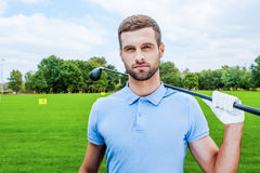 Confident golfer. Royalty Free Stock Image