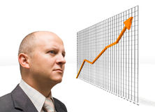 Confident Growth. Confident Business Man looking at growth graphic stock image