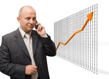 Confident Growth. Confident Business Man looking at growth graphic stock photography