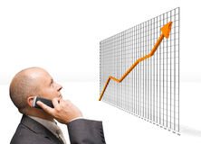 Confident Growth. Confident Business Man looking at growth graphic stock photos