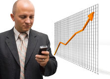 Confident Growth. Confident Business Man announcing partners about financial growth Royalty Free Stock Photo