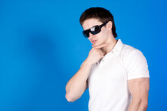 Confident guy with the glasses in the studio Stock Photography