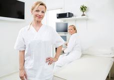 Confident Gynecologist With Colleague In Royalty Free Stock Image
