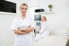 Confident Gynecologists In Examination Room Stock Photo