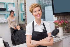 Confident hairdresser smiling at camera Stock Images