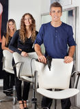 Confident Hairdressers With Hairdryer And Scissors Stock Photos