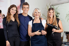 Confident Hairdressers Standing Together Stock Photography