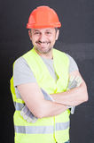 Confident handsome builder posing with arms crossed Royalty Free Stock Image