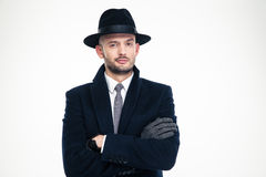 Confident handsome business man in coat, hat and gloves. Standing over white background Royalty Free Stock Photos