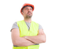 Confident handsome constructor posing with folded arms Stock Photo