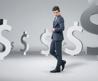 Confident handsome man among the money Stock Images