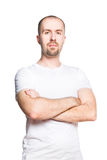 Confident handsome man in white t-shirt isolated on white stock photography