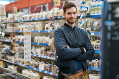 Confident handyman in a hardware store Stock Photos