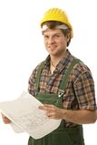 Confident handyman holding floor plan Royalty Free Stock Photo