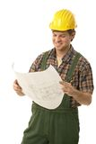 Confident handyman holding floor plan Stock Photo